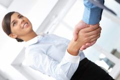 Agree. Businesswoman shaking hands with her colleague Stock Image