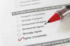 Agree Completely. Closeup of a survey form, with Agree Completely checked Stock Images