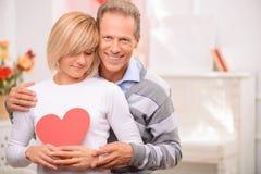 Agreeable couple celebrating St Valentine day Royalty Free Stock Photos