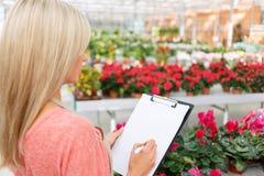 Agreeable florist holding folder Stock Photo