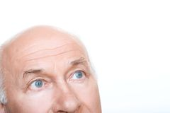 Agreeable grandfather looking up Royalty Free Stock Photography