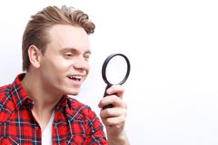 Agreeable guy keeping loupe Stock Images