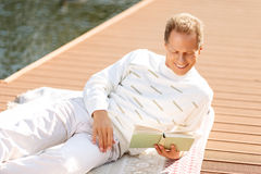 Agreeable man reading a book Royalty Free Stock Photo