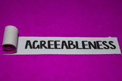 Agreeableness text, Inspiration and positive vibes concept on purple torn paper stock image