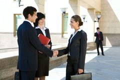 Agreement. Photo of successful people making an agreement Stock Image