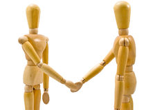 Agreement. Two wooden figures shaking hands in agreement Stock Photo
