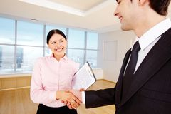 Agreement. Photo of happy partners handshaking after signing contract Stock Images