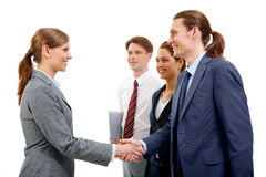 Agreement. Photo of successful partners handshaking after signing contract Royalty Free Stock Photo