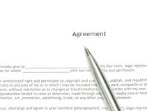 Agreement. An agreement detail with a pen over it Stock Photo
