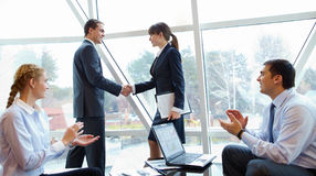 Agreement. Photo of confident partners handshaking at meeting after making an agreement Royalty Free Stock Photo