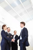 Agreement. Image of business people handshaking after signing agreement Royalty Free Stock Photo