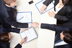 Agreement. Above view of business partners handshaking after signing contract Royalty Free Stock Photos