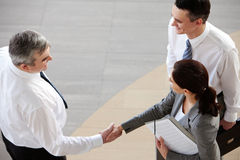 Agreement. Image of business partners handshaking after signing contract Stock Image