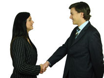 Agreement. Young man and woman in business suits shaking hands Stock Photography