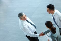 Agreement. Image of business partners handshaking after signing contract Royalty Free Stock Image