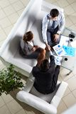Agreement. Above angle of successful associates making agreement at meeting Royalty Free Stock Photo