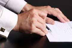 Agreement. Close-up of a men hand signing a contrat royalty free stock images