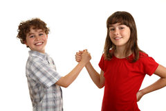 Agreement. Two kids shaking hands isolated on white Royalty Free Stock Images