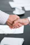 Agreement. Photo of partners� hands making agreement by handshaking Stock Photos