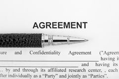 Agreement and black pen Royalty Free Stock Photo