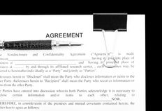 Agreement and black pen Royalty Free Stock Image
