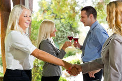Agreement is concluded. Businesspeople in restaurant make a agreement Stock Photos