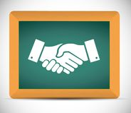 Agreement handshake chalkboard sign concept Royalty Free Stock Image