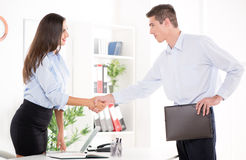 Agreement. Happy successful businesswoman and businessman shake hands after meeting in the office Royalty Free Stock Photo