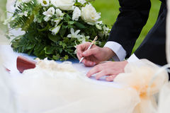 Agreement of marriage. Groom put his signature to the agreement of marriage Royalty Free Stock Image