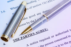 Agreement  and metal pen Stock Photography