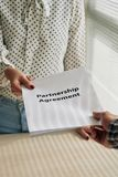 Agreement. Partnership agreement in hands of business people Royalty Free Stock Images