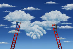 Agreement Plan. And business deal with a business group of two businessmen climbing ladders working together in partnership to shape clouds in the sky as a Stock Photos