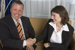 Agreement reached. A businessman an businesswoman smartly dressed reaching an agreement Stock Photo