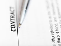 Agreement and tip of silver pen Stock Photo