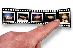 Agreements. Film strip with hands shaking stock image