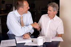 Agreemnet. Two businessman have a deal, focus on the senior businessman royalty free stock image
