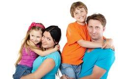 Agregado familiar com quatro membros foto de stock