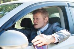 Agressieve gedronken bestuurder bij het wiel stock afbeelding
