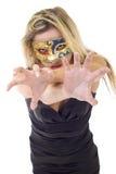 Agressieve gemaskeerde vrouw Stock Foto