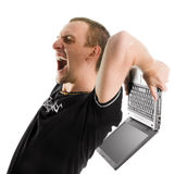 Agression. Anger men destroy a laptop isolated on white Stock Photos