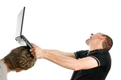 Agression. Young men destroy a laptop royalty free stock photo