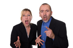 Agression at work. Man and women shouting loud Stock Image