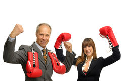 Agressive business. Business couple with boxing gloves isolated in white Royalty Free Stock Image