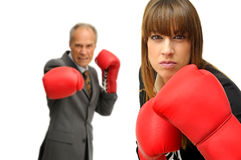 Agressive business. Business couple with boxing gloves isolated in white Royalty Free Stock Images