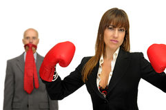 Agressive business. Businesswoman with boxing gloves and businessman under domination isolated in white Royalty Free Stock Photo