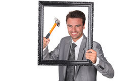 Agressive businessman with picture frame Royalty Free Stock Photography