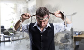 Agressive businessman with a tie on his head. Agressive businessman fighter with a tie on his head in the office Stock Photos