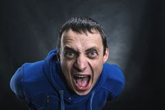 Agressive man in the dark Stock Photos