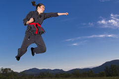 Agressive ninja girl in the air Stock Photo