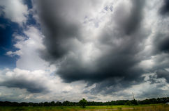 Agressive thunderstorm cloouds sky over farm land Royalty Free Stock Photography
